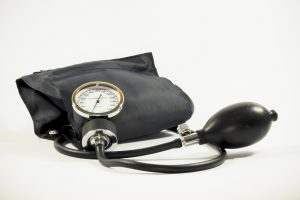 Blood pressure cuff used to screen for blood pressure pre-existing conditions